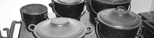 Cooking range with four cast iron pots