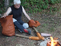Experimental copper smelting using traditional hand bellows